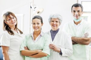 Group of dentists and their assistants looking at camera.